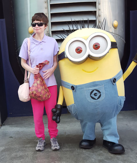 Daphne with a minion at universal studios. Niether of them were paying attention.